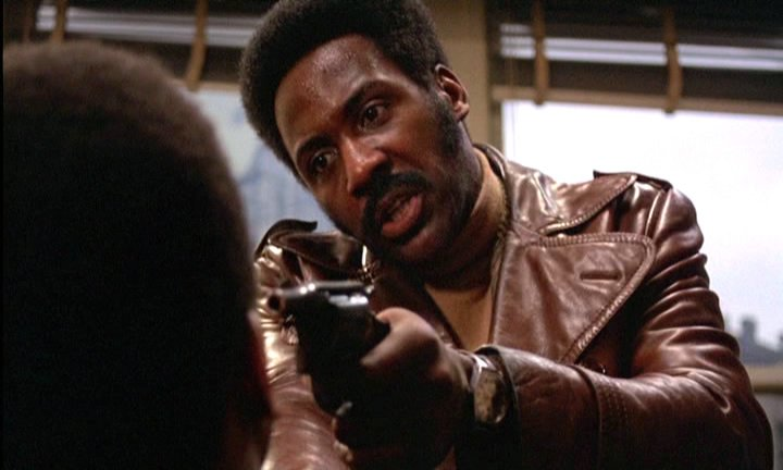 Shaft holds a cat at gunpoint.